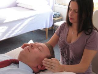 Reiki Master Teacher Giving Reiki Treatment