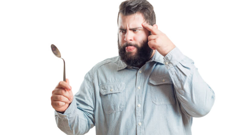 Intuitive Man Bending A Spoon